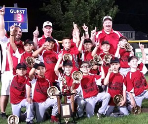 "Photo courtesy Dan Watson The 8-year-old Kearny All-Stars celebrate after winning the Lyndhurst Junior Baseball League Tournament championship last week by defeating Hoboken, 4-3, in the title game, capturing ""The Tournament"" for the first time ever."