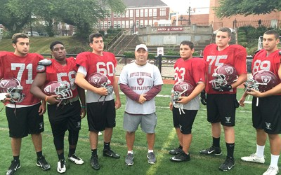 Photo by Jim Hague The Nutley football team will be an improved bunch this year, thanks to the play of the Maroon Raiders' offensive line. From l. are Augie Mustardo, Devin White, Dan Chagnon, head coach Tom Basile, Mark Charles, Nick Lovato and Brian Hewett.
