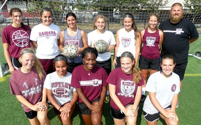 Photo by Jim Hague The Nutley girls' soccer team looks solid once again this season, already posting three victories on the young season. Front row, from l., are Lauren Holden, Melissa Alvarez, Jaela Small, Natalie Muzzicato and Marcella Lampon. Back row, from l., are Cassie Angelo, Angeli Bossbaly, Sarah Roselli, Alessandra Santoriello, Darby Fischer, Erin Neri and head coach Mike DiPiano.