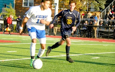 Photos by Jim Hague North Arlington senior defender Moises Polanco (16) moves forward with the ball and away from Brearley's Darion Ferrera during last Friday's NJSIAA North Jersey Section 2, Group I boys' soccer sectional championship game at Rip Collins Field in North Arlington, a game won by Brearley, 3-0.