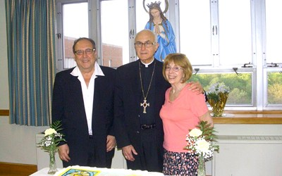 Photos courtesy Richard Donato. The late Bishop Thomas Donato (c.) fl anked by cousins Richard Donato and Joan Donato of Kearny in May 2015.
