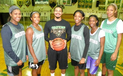 Photoo by Jim Hague Queen of Peace has a new girls' basketball coach in Jiovanny Fontan (c.) as well as basically an entire new roster. From l. are Jamira Watkins, Sydney Watkins, Fontan, Asonah Alexander, D'Aviyon Magazine and Raven Farley-Clark.