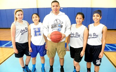 Photo by Jim Hague The Harrison girls' basketball team has a shortened roster this year, but will be a tough out as always. From l. are Alona Ortiz, Shaneida Falcon, head coach Al Ruiz, Kimberly Valencia and Tabatha Ferreira.