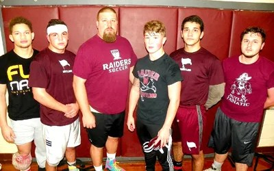 Photoo by Jim Hague The Nutley wrestling team is ready to take on all comers with new head coach Mike DiPiano in charge. From l., are Darwin Pena, John Zarra, DiPiano, Robert Duxbury, Louis Long and Gerard D'Alessio.