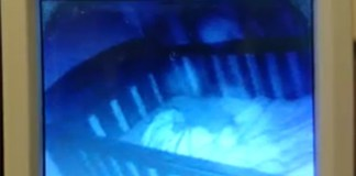 Mother Films Ghosts on The Baby Monitor As They Appear Next To Her Sleeping Daughter