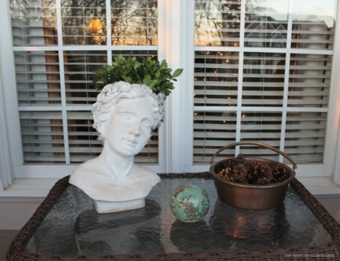 lady-head-planter-pinecones-copper-pot-christmas-porch