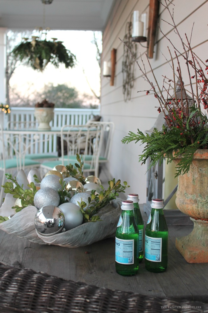long-shot-porch-closeup-greenery-and-berries-pellegrino-bottles