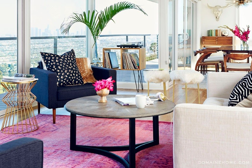 white-couch-design-with-zebra-patterned-cushion-and-navy-blue-single-sofa-with-round-coffee-table-and-pink-overdyed-rug