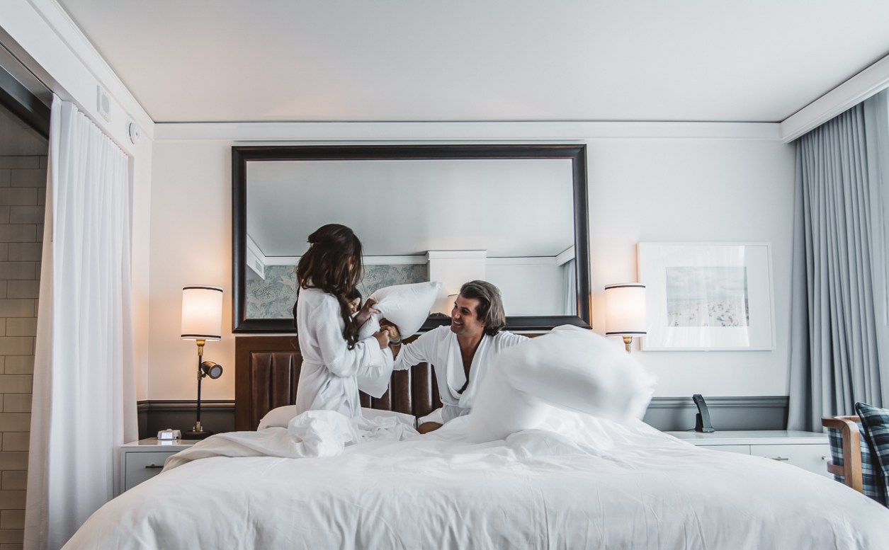 Pillow Fight Couple Hotel Bed