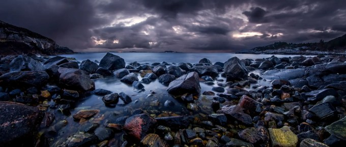 500px Photo ID: 108748239 - I went out to this little island called Bjørnøya for sunset and even as the colors faded near 11 or midnight, as there is hardly any darkness here in Norway anymore. I went down to the shoreline to check out the rocks and see what sculptures have been made by the waves over time. This part of the shore doesn't have many anomalies but still very pleasing to the eyes for me, and wanted to share. I plan on visiting the shore once again to look at the different formations.