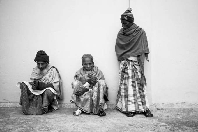 Three leprosy patients on the terrace of a hospital in West Bengal, India