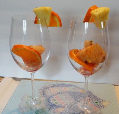 Once the fruit has been propperly steeped in the wine mixture, take a few pieces and place in individual glasses.  (then I use fresh fruit to garnish the rims of the glasses as shown here)