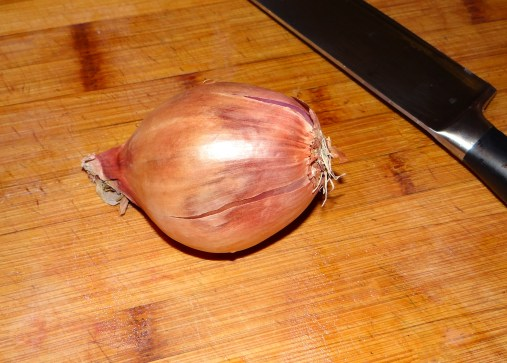This is a shallot... a rather large shallot actually.  It is a milder cousin of the onion.  Because I find this to be a more delicate chowder, I didn't want to overwhelm the flavor with onion.