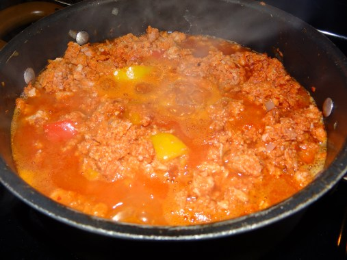 As the cooking process goes on some of the fat is released from the chouriço and it becomes much more liquidy.  Continue to cook until that liquid gets reduced by about half.  In the end, you still want it moist.