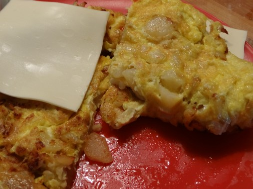 Gently fold the egg up and over the cheese.