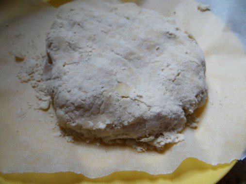Divide the dough in two and place on a plate divided by parchment paper.