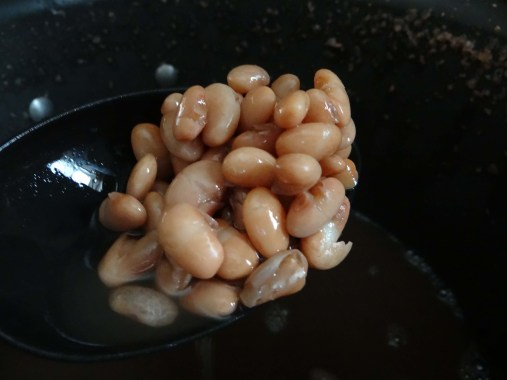 After they have boiled for about two hours, you will have beans that are busting open on their own. This is the desired effect. You in no way want aldente beans. You want smushy beans.