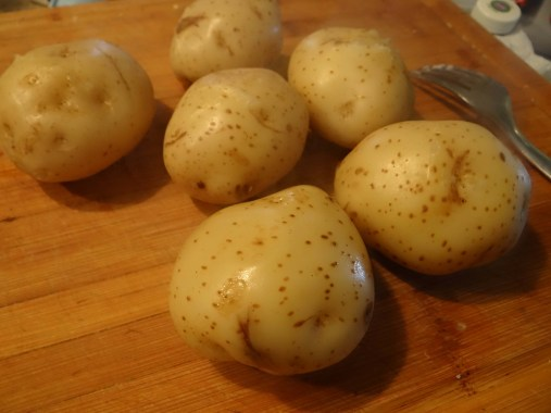 Once potatoes have been boiling for 10 minutes, drain water and allow to cool before working with them.