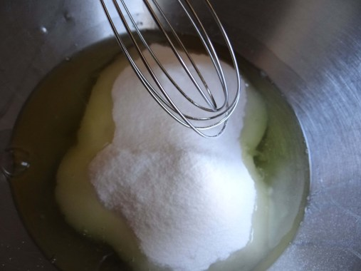 With a hand whisk, incorporate the sugar in with the whites by beating well.