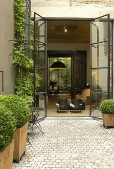 Glass doors with potted boxwoods