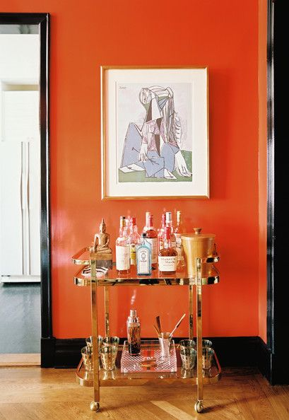 Bar cart with Orange Wall via Lonny