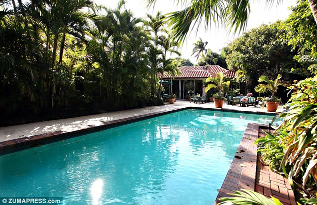 In the land of lilly the potted boxwood - Palm beach pool ...