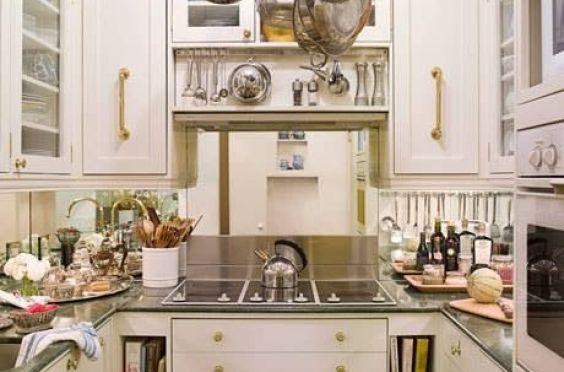 Mirrored Backsplash makes this kitchen feel better