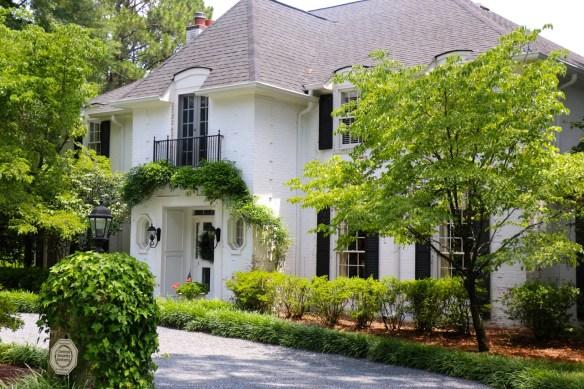 White home with black shutters in Pinehurst