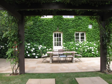 Pergola with hydrangeas and boston ivy by Paul Bangay via Pinterest