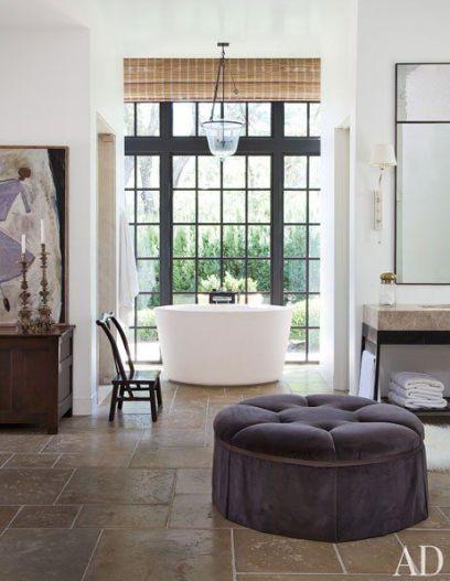 Ottoman in bathroom via AD