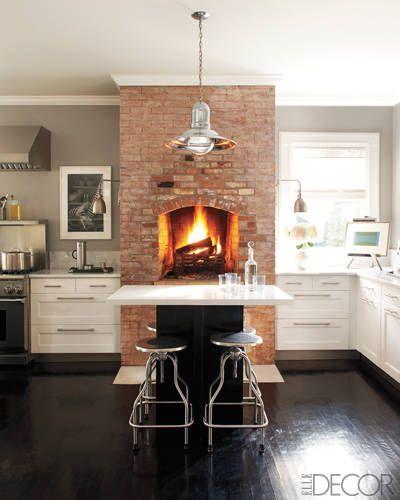 A dreamy kitchen with a brick oven fire via Elle Decor