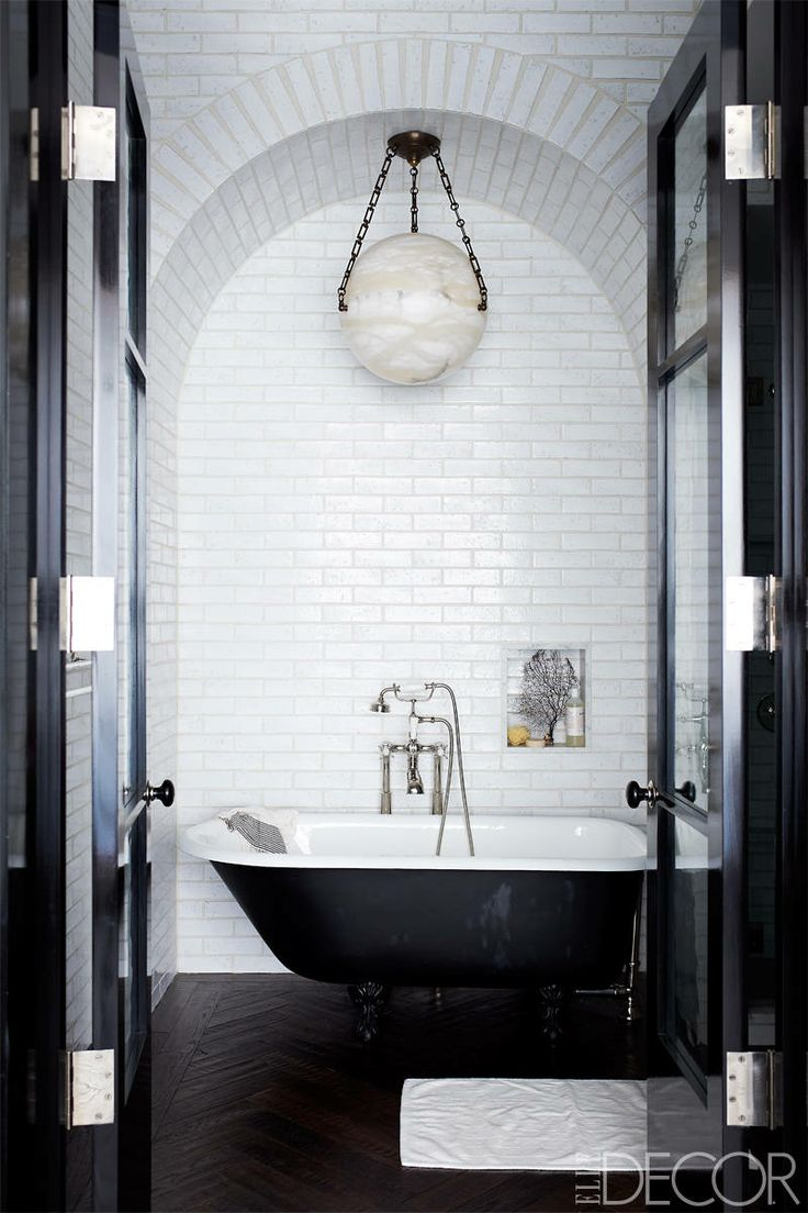 floors the potted boxwood a simple and stunning bathroom full of contrast and dark herringbone floors photo source elle decor