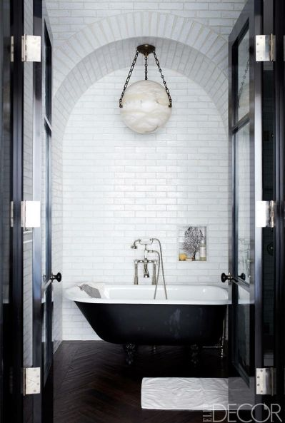 Coldplays Jonny Buckland bathroom with herringbone floors via Elle Decor