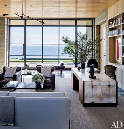 Malibu blue ocean is the backdrop for these warm leather chairs in ADjpg