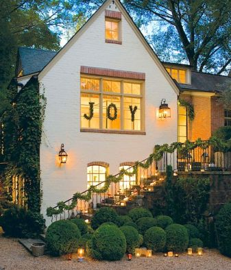 Front of a home decorated for the holidays