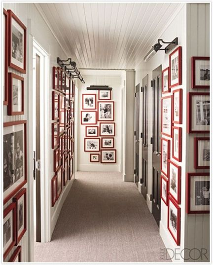 Hallway of Red picture frames via Elle Decor