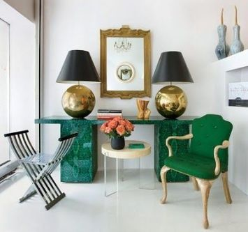 Malachite side table and brass lamps via Elle Decor