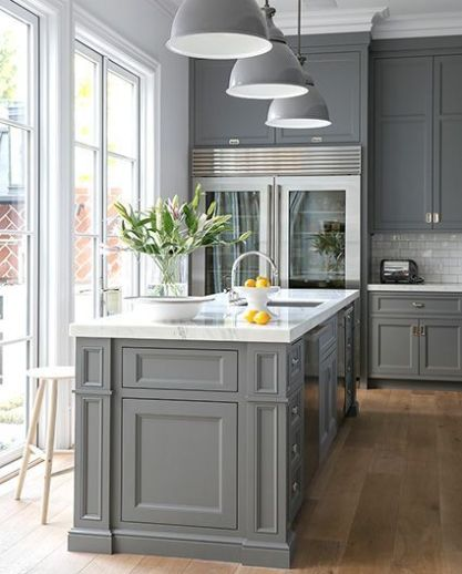 Gray kitchen with glass fridge via Lonny