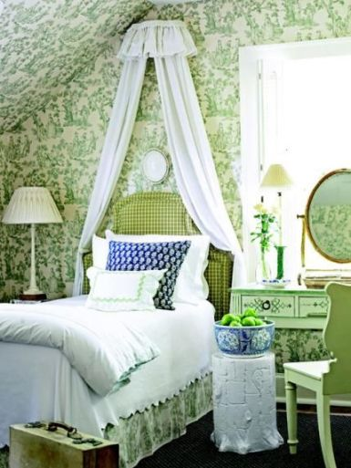 Green and white toile with accents of blue via Traditional Home