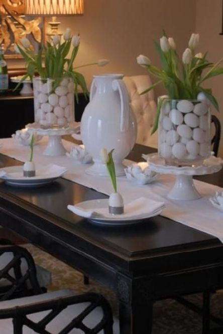 Egg filled glass vases with tulips for a Easter tablescape