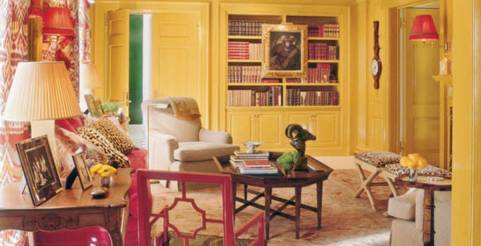 Yellow walls in this den via Veranda