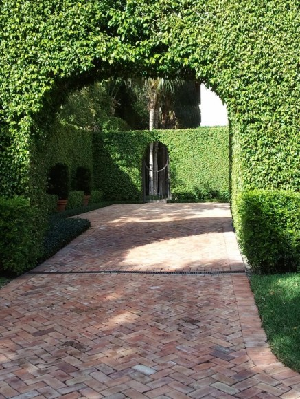 Hedged driveway with herringbone brick