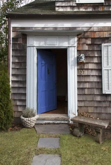 Michelle Smiths Sag Harbor blue front door via Lonny