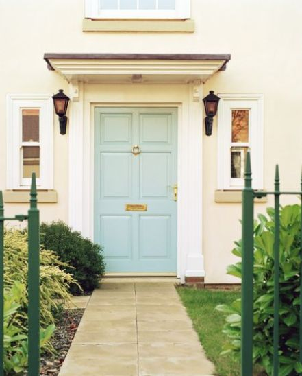 blue front door via house beautiful