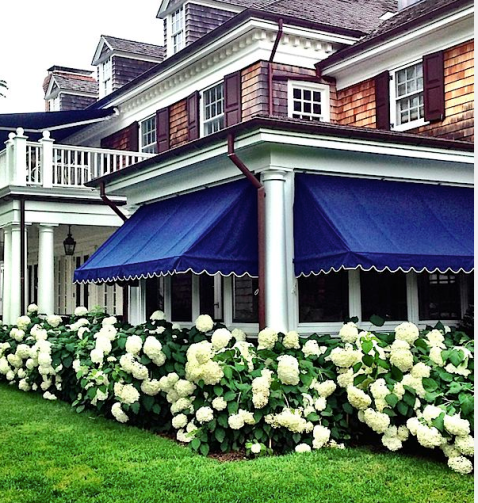 Navy awnings at the home of Alex Papachrisdis