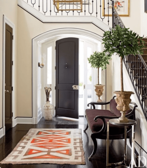 Accents of orange in this entry runner via AD