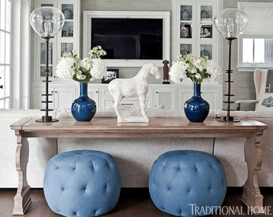 TV room with blue ottomans