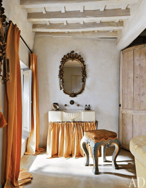 dusty orange curtains and apricot skirted sink via AD
