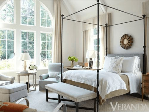 Iron bed with lots of light via Veranda