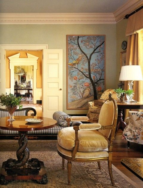 Chinoiserie panel framed in a living room by Suzanne Rheinstein